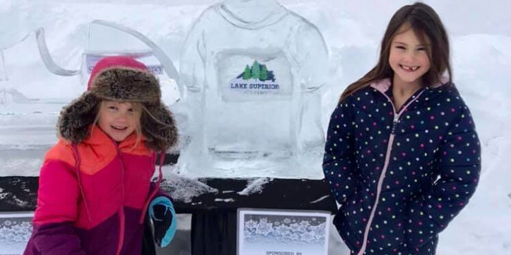 kids standing next to lake superior academy ice sculpture