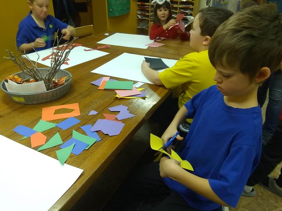 Students working on an art project using craft paper