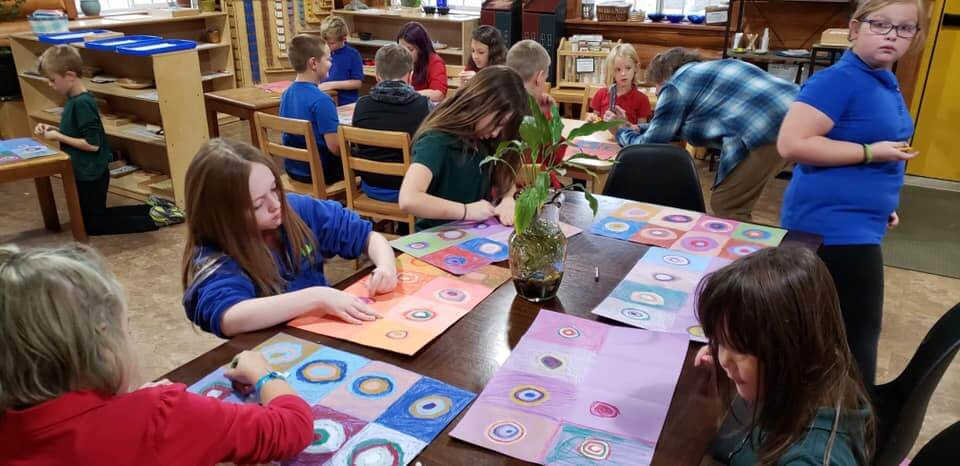 A group of many students working on their square art