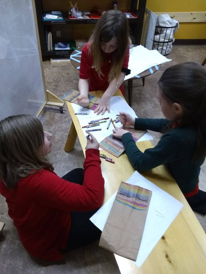 Students working on African inspired art project