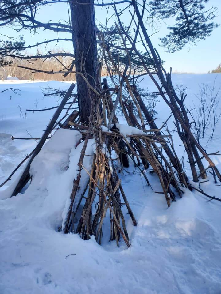 Shelter built from sticks by LSA students