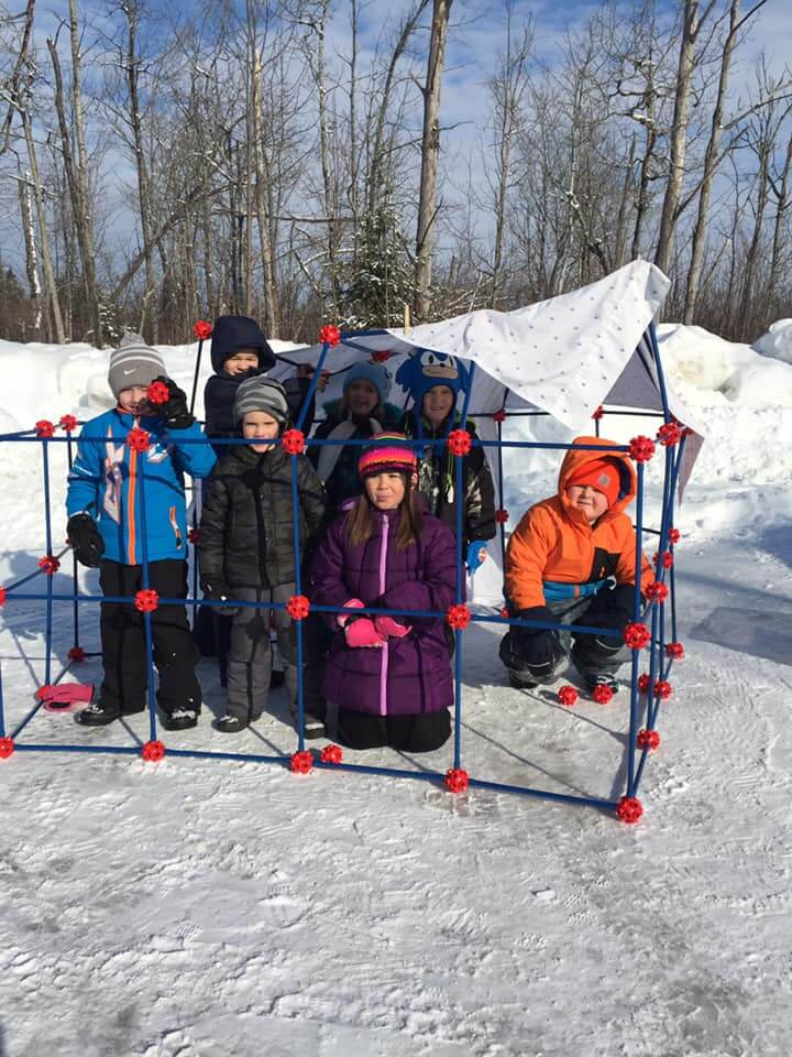 Students outside building an igloo structure 2