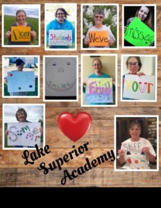 "Lake Superior staff holding signs with the message, ""Dear students, we've missed your smiles! Enjoy your summer!"""
